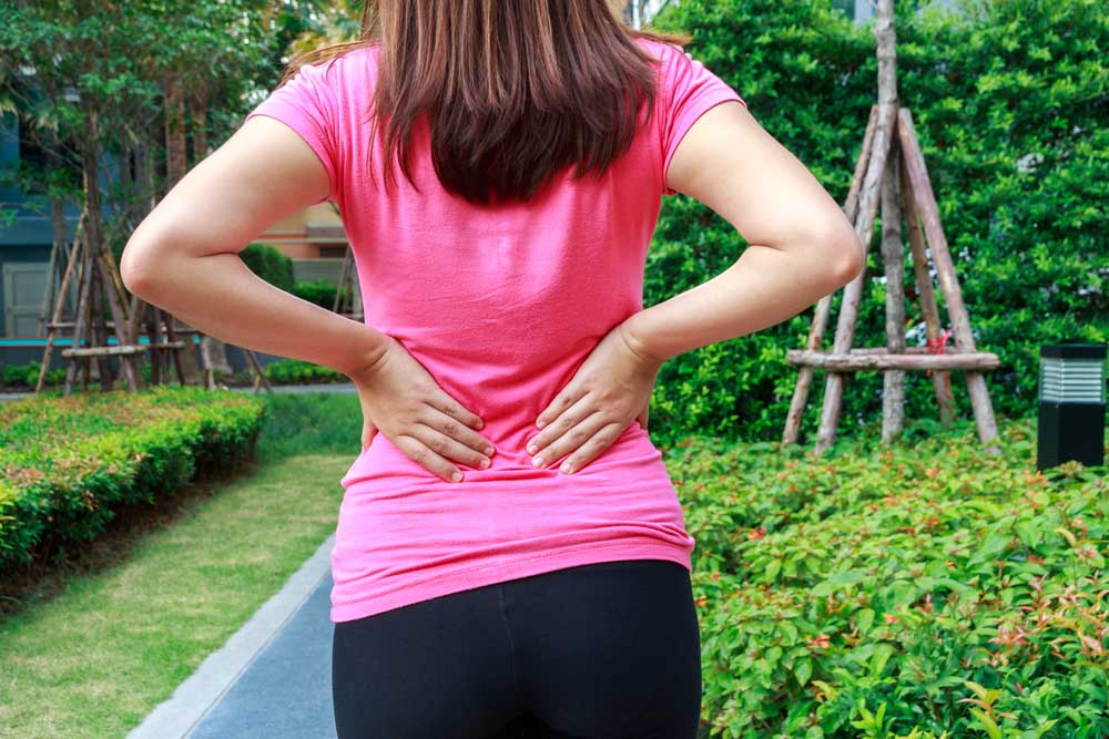 Woman with back pain in Anniston, AL.